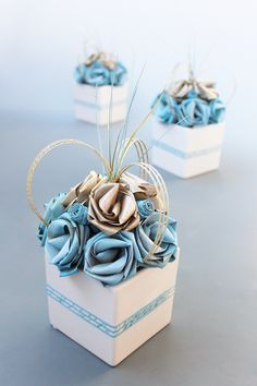 Pale blue and gold centrepiece in a white ceramic cube.  www.flaxation.co.nz