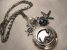 Mermaid and Compass Locket Necklace Silver Plated with Pearls. $22.00, via Etsy.