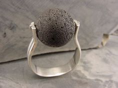 Ring |  Christine L Sundt.  'Ball of Fire' Lava, sterling silver