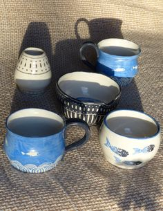 Some things I made in Rachel Dormor's pottery class in Cambridge, using sgraffito and underglaze pencil for the designs