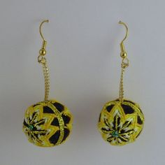 Temari is a traditional art from Japan. These temari earrings are handmade and have an intricate stitched design made with cotton thread. The core of