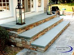 Natural Stone with Bluestone Steppers onto a Stamped Concrete Pool Deck  www.environmentalpools.com