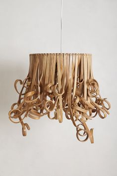 Alright points for uniqueness.  Was this inspired by an octopus?  Small childs hair ringlets? Spaghetti?  Either way I'm super enamoured with it and you should be, too!  Conversation piece for sure. Curlicue Pendant Lamp - Anthropologie.com #Anthropologie #PinToWin