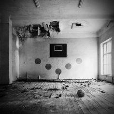 Abandoned room with basketball and backboard
