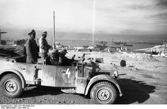 Generals  Rommel und Bayerlein on their staff Horch car in the port of Tobruk.  Tobruk, North Africa  June 1942