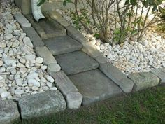 Down spout river bed - like this concept but would use thinner, stacked rocks in a curved pattern