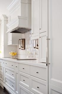 White kitchen inspiration, with profiled doors and traditional details - By Elizabeth Metcalfe Interiors & Design Inc