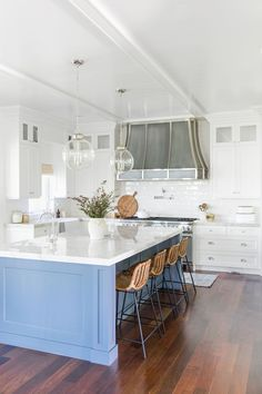 Traditional kitchen design inspiration, bright and airy home, blue kitchen island, silver chrome range hood | Studio McGee Blog
