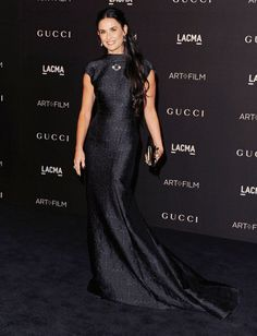 Pin for Later: Hot Hollywood Stars Trade Halloween Costumes For Red Carpet Glamour  Demi Moore wore a black gown.