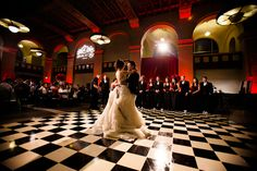 Love the black and white checked floor at Majestic Halls in LA, first dance photo by Callaway Gable | via junebugweddings.com