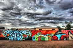 """Shots of recent work to a Calle 16 mural located on 16th Street between Thomas & Osborn. Artists include Angel Diaz, Lalo Cota, Griffin One, Thomas """"Breeze"""" Marcus, Ishmael Duenas, and Pablo Luna."""