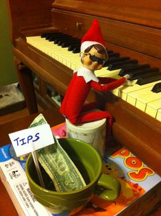 I also have my piano lesson tonight - will pull out the old Christmas carols v scheduled lesson :) Elf on the Shelf playing the piano..