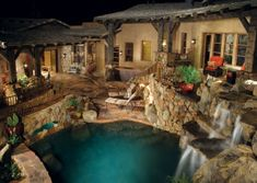nicely landscaped back yard with bridge, #pool, waterfalls and stone patio
