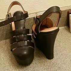Black wedges Very cute black wedges. Never worn only tried on. Shoes Wedges