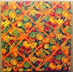 "Fall Veggies with Orange Crisscross message ribbons; custom fabric covered cork bulletin board  Code 11122  24"" x 24""  $75.90 Fabric Bulletin Board, Cork Bulletin Boards, Fall Vegetables, Veggies, Fabric Corkboard, Fabric Wall Art, Wall Art Pictures, Fabric Covered, Custom Fabric"