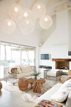 See 25 gorgeous beach house interior  inspirations: Natural accents and floating white globe lights.