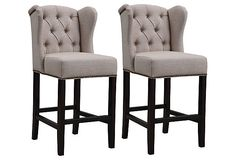 """These are the most attractive bar stools I've ever seen. They're the exact opposite of """"seedy bachelor pad""""."""
