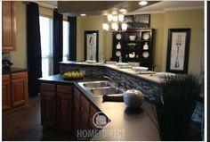 model home dream room kitchen dark framed fork and spoon
