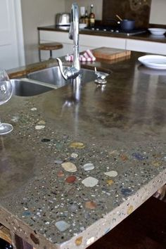 Concrete counter, but it looks awesome! Wonder if you could 'design' your own concrete?                                                                                                                                                                                 More