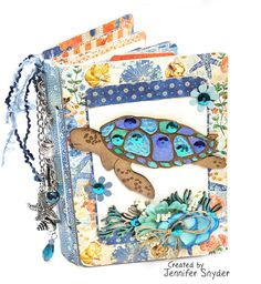 """Scrap Escape: Sea Turtle Mini-Album Passbook Mini album (passbook by Eileen Hull Designs) featuring the fabulous sea turtle chipboard from Creative Embellishments, papers from Graphic 45, passbook from Sizzix and Eileen Hull Designs.  Don't know how to paint? I don't either.  See my easy """" Jen cheat method"""" of painting the sea turtle on my blog.  #CreativeEmbellishments #seaTurtles  #EileenHullDesigns #sizzix #graphic45 #chipboard #DIYminiAlbums"""