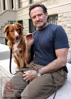"""ROBIN WILLIAMS 4.6.05<br /> STEVE SANDS PHOTO-<br /> NEW YORK NEWSWIRE<br /> OFFICE:212 673-3398<br /> CELL: 917 673-5739<br /> High fives RILEY while hanging out inbetween scenes for his new film """"THE NIGHT LISTNER"""" now filming in NY. He premieres the David Ducovney directed film """"HOUSE OF D"""" next week."""