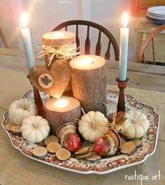 don't love the whole arrangement, but I do like the logs with candles in them