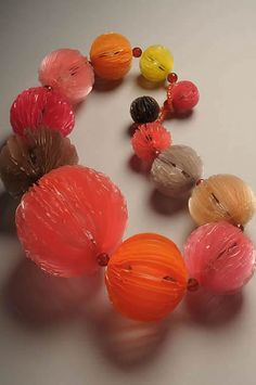 """""""Yuka Saito is a Japanese artist who works with polypropylene and other plastics to create colorful and ephemeral jewelry that often suggests natural forms."""""""