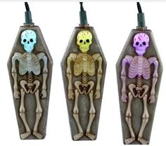"""SKELETON TOMBSTONE Halloween LED Light Strand NEW by Kurt Adler. $19.99. Skeleton Tombstone -  Light StrandFeatures:Creepy Light Up Skeletons encased in a Tombstone, color changing low-wattage LED lights are inside these 7"""" plastic Skeletons. 10 light set of Skeletons are 2-sided, see additional photos to see reverse side of skeletons.  This 10/light Set includes 30-inch lead green wire, 12-inch spacing between skeletons, LED color changing bulbs and 1 spare fuse. This light s..."""