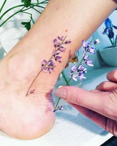 Small flower tattoo made during Botanical event