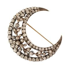 Antique Silver-Topped Diamond Gold Crescent Brooch. Silver-topped 14 karat gold brooch designed as an openwork crescent with a foliate motif set with old mine diamonds weighing approximately 6.25 carats, measuring 1 7/8 by 1 7/8 inches, pin is removable, mid 19th century.