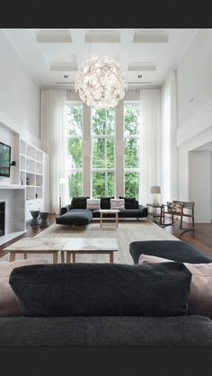 Dark grey, stark white. Love the high ceiling, curtains and pendant light :)