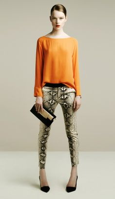 Spring Summer 2014 trend: Animal prints will be in vogue..Tangerine top adds to the look. Simple yet trendy.