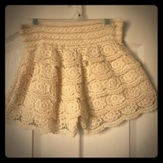 Crochet Layered Mini Shorts These cute shorts have a layered design with a wide waistband. The lace scalloped lace is 100% cotton with a polyester lining. The size is M but fits more like a S. Worn once but found it too short. In great condition! Ananda's Collection Shorts