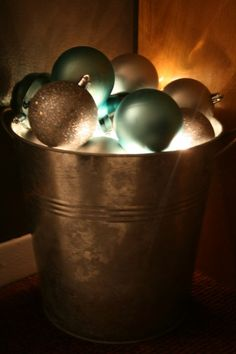 Christmas bulbs & lights...would be pretty in one of my coke buckets with red instead of blue bulbs