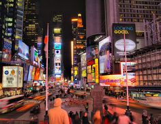 New York City. So many people all with different stories in one beautifully lit at night location :) coolest thing ever.