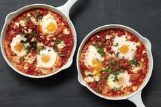 Poached Eggs in Tomato Sauce with Chickpeas and Feta / Lisa Hubbard