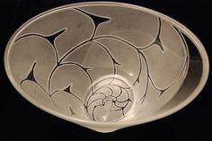Nautilus design on a-symmetrical bowl. sold