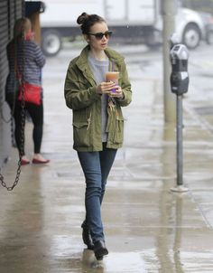 Lily Collins out in the rain in Beverly Hills