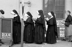 Waiting in line at the polling place - The juxtaposition of the nuns and the Dixie Beer sign in this photo makes it one of my all-time favorite finds. I would've known this was New Orleans no matter where I ran into this image!  (The