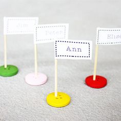 Having guests? Make cute table name flags from buttons and toothpicks! Also nice with christmas ribbon..