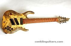 """Conklin 8 string with fanned frets (22.75"""" - 25.5""""). I guess it has a high A with that scale."""