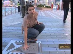 Hong Kong's Avenue of Stars with marks of Jackie Chan, John Woo, Jet Li, and others. Hong Kong has its own version of Avenue of the Stars, located in Tsim Sh. John Woo, Jet Li, Jackie Chan, Travel Videos, China Travel, Culture Travel, Hong Kong, Stars, People