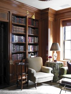 """"""" Love this glossy library with a contemporary brass library light and a chintz skirted table nicely blending that masculine, feminine, tailored and country. """""""