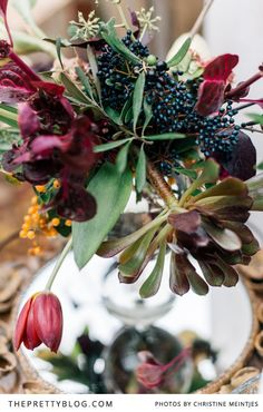 Beautiful Flower arrangement | Colors of ruby and Plum |    Flowers & Venue: Flowers in the Foyer