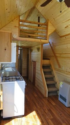 """Spacious Tiny House Living in Richs Portable Cabins. The space under these steps has been smartly put into use for storage or a washer dryer combo. Note that it is what Rich's website calls a """"stand up stairs"""" - no ducking required to climb up."""