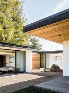 Cedar wood, natural stone and glass in a modern house in California