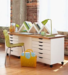 Craft Storage Ideas blog/ craft table made from Alex drawers from IKEA and a wood table top. Castors were added to the bottoms of the drawers to make this desk mobile.