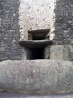 Art on the entrance stone at Newgrange in Ireland