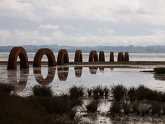 andy goldsworthy How wonderful- the reflection leading out beyond the land.
