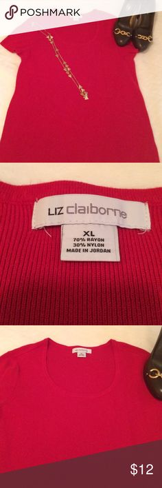 Liz Claiborne stretchy sweater Very nice lightweight sweater. Short sleeves and scoop neck. Very light discoloration at bottom. Can barely see. May be the way material is laying. Nice top. Liz Claiborne Tops Blouses